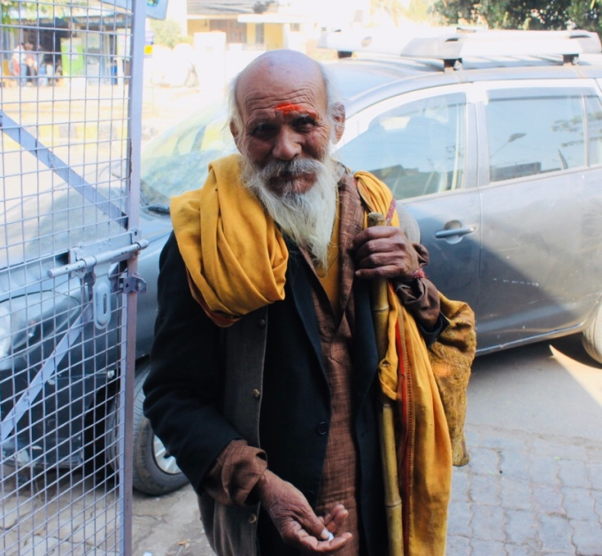 A sadhu asking for money, India, 2017